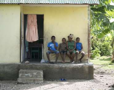 Vilia and sons outside her hurricane-resistant home in Torbeck, Haiti