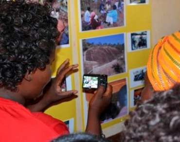 Three community photo monitors from Kalawani - Jackson Kawewa, Justus Nzioki and Mary Mutungi - were trained in basic photography