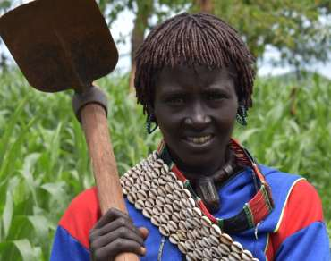 Hasarra holds one of the tools she was given to help with crop planting. Farming tools were provided to villagers in Sheba kebele, Bena Tsemay District, by Women Support Association, with the Support of UK's Disaster Emergency Committee.