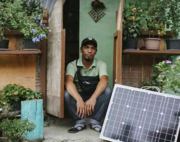 Randy Zosa pictured with solar panel