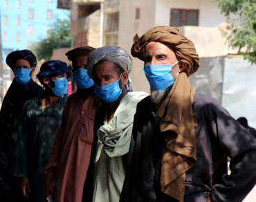 Men listening to a hygiene talk in Afghanistan