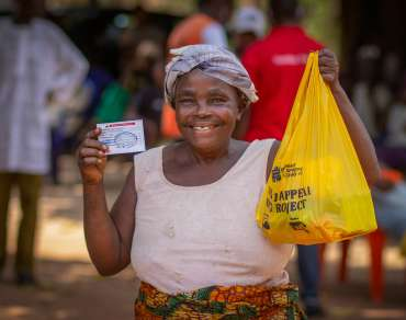 A woman in Benue state Nigeria very happy to recieve a COVID hygiene kit from Christian Aid