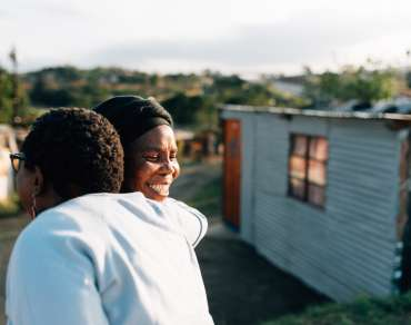 Two activists embrace in KwaMashu, an informal settlement north of Durban, South Africa