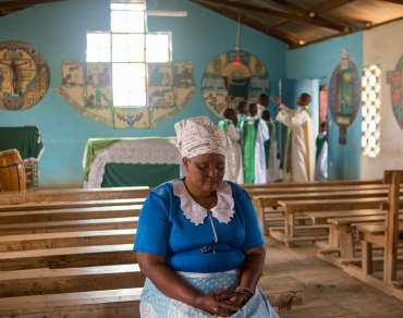 Florence praying in a church in Kenya