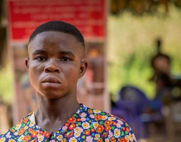 Sonter is an 18-year-old orphan. He is a farmer and lives with his elder sister. He is not in school because he couldn't afford his school fees. He works as a farmhand and gets a daily wage to meet his needs.