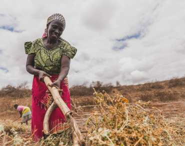Rose digging a field in Kenya