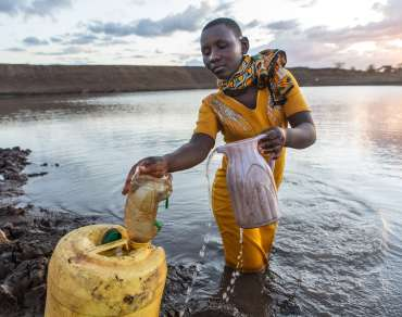 Kasyoka Mwanzia walks every other day to the Kyeng'e dam to collect water.