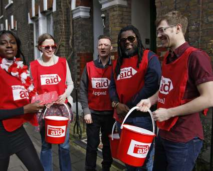 Christian Aid collectors on a residential street