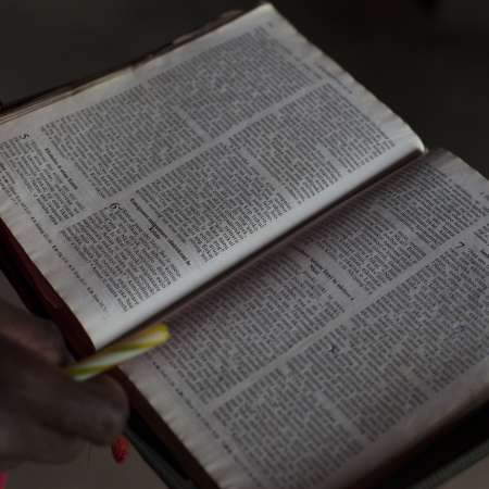 Open Bible held in hands