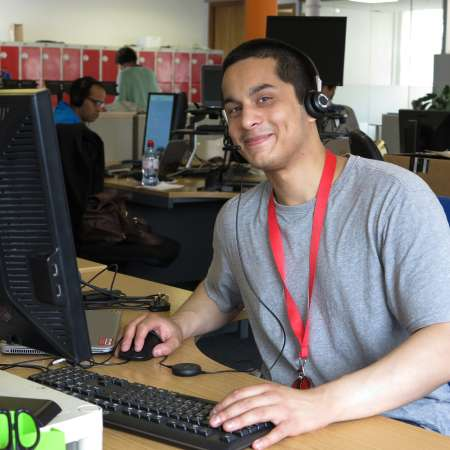 Christian Aid volunteer sitting at a desk
