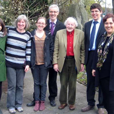 Wales regional team stand with Christian Aid Chief Executive, Loretta Minghella