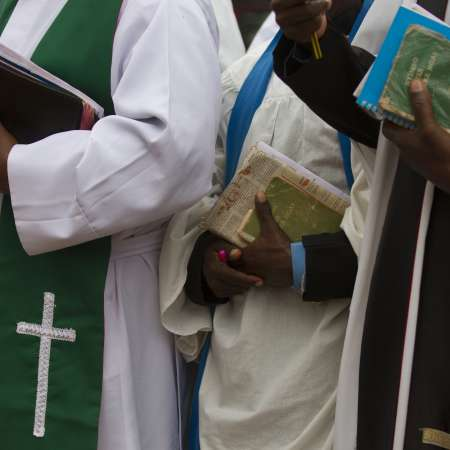 Books and clothing held and worn by clergy in Kenya
