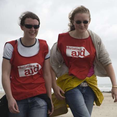 Two girls taking part in the Bournemouth and Poole sponsored walk