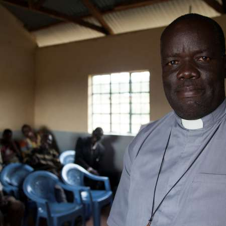 Father Vincent Yoga in church, Kenya