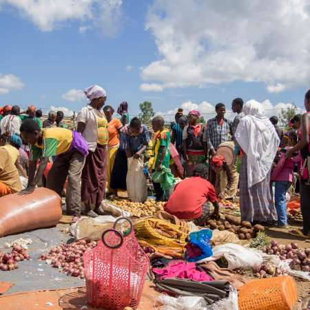 Women trading produce in a market in Jinka, South Omo