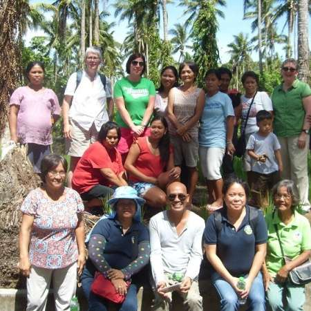 A group of people, including Christian Aid Wales staff, involved in Christian Aid's work in the Philippines