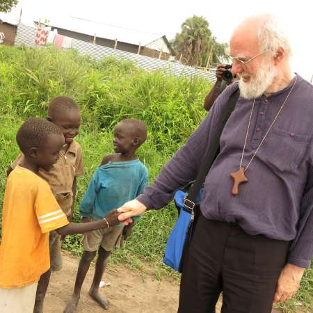 Dr Rowan Williams and children in South Sudan