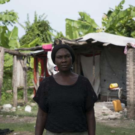 Jocelyne in front of her makeshift house