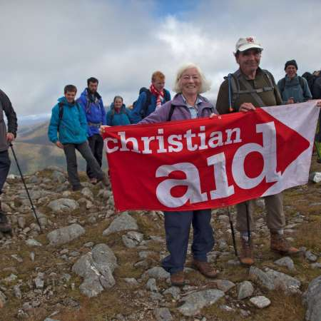 A group of climbers with Christian Aid banner