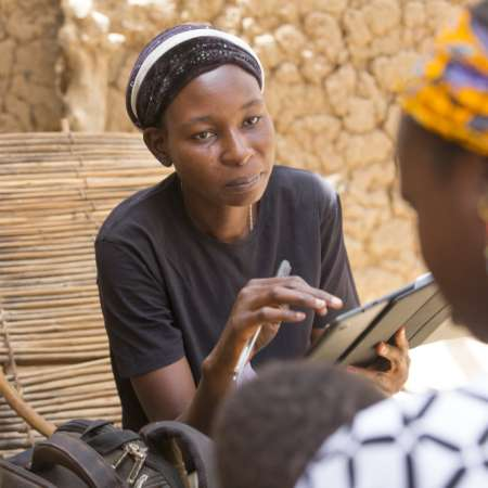 Sally Belem, 32, conducts a survey into child nutrition in the Yako area of Burkina Faso as part of a two year study.