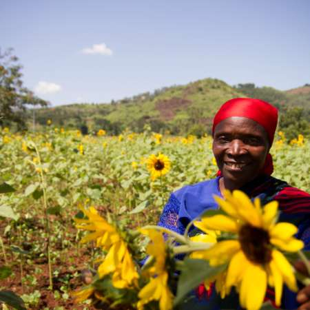Melanie smiling in Burundi sunflower field