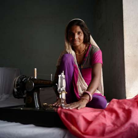 Ranjita uses her sewing machine provided by Christian Aid to help lift her family out of poverty.