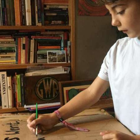 child writing letter for creation